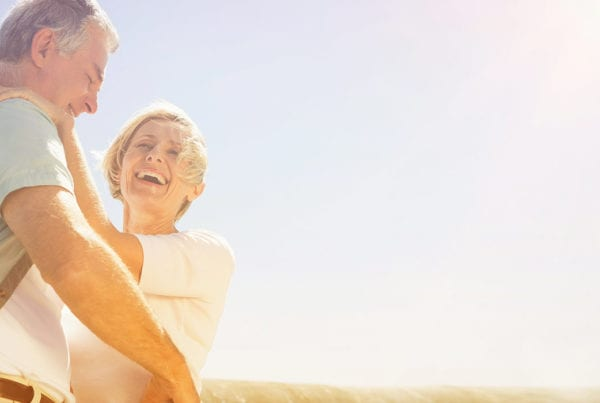 Older couple smiling in sun